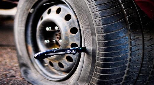 bigstock-knife-in-tire-10979330.jpg